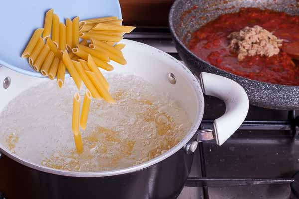 Once the water boils throw the penne in...