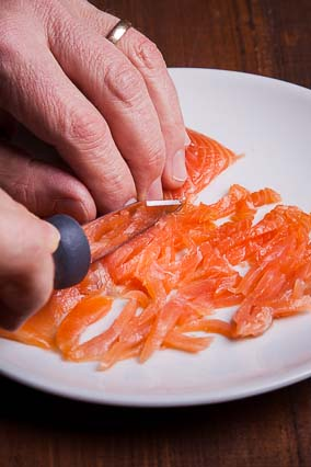 Cut in Thin Strips the Smoked Salmon